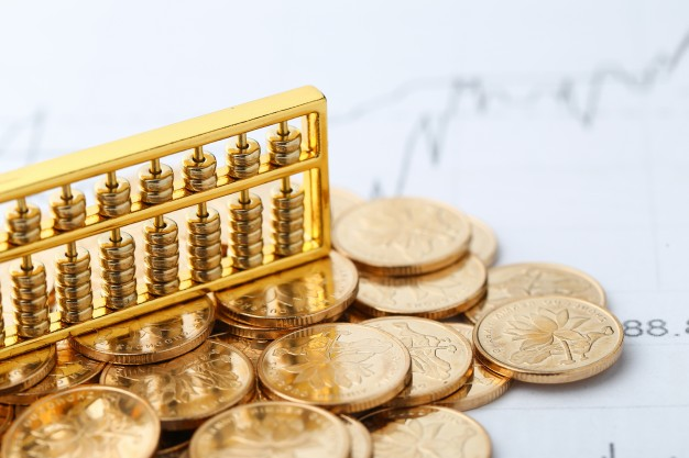 golden-abacus-with-chinese-rmb-gold-coins-as-background_1387-45.jpg